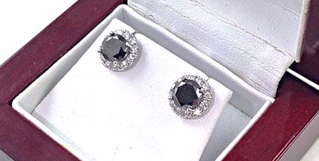 Custom Design: 2.00 carat round Black diamonds set in 18k white gold diamond halo stud setting.