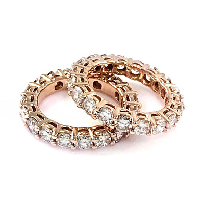 7.73 carat round brilliant cut diamond eternity rings set in 14k rose gold