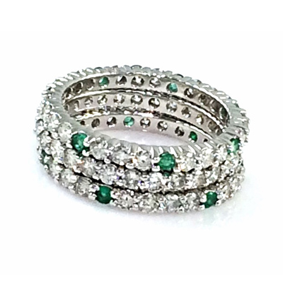 Custom made diamond stack bands. One ring with round brilliant cut diamonds and two rings with natural emeralds & diamonds. Total diamond carat weight: 2.85 ct