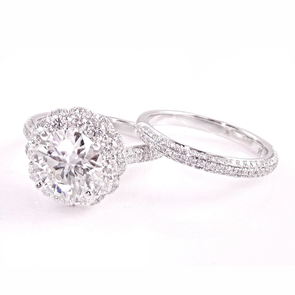 Custom designed 18k white gold diamond halo engagement ring with matching wedding band. Total diamond carat weight: 4.62 ct