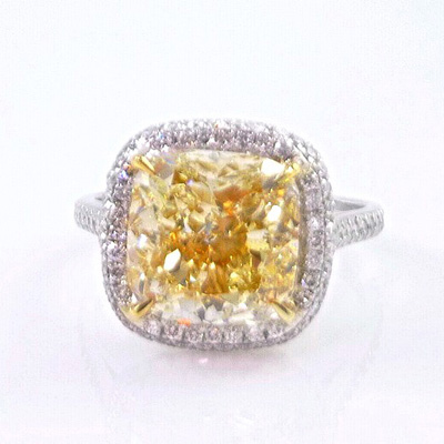 Custom design 6.00 carat fancy yellow cushion cut diamond engagement ring in platinum with 2.00 carat pave diamond accents. Total diamond carat weight: 8.00 ct