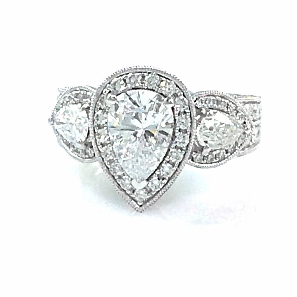 Custom Design 1.22 pear shape diamond with two pear shape accent diamonds .60 ct set into a custom made 18k white gold halo engagement ring. Total diamond carat weight: 2.79 ct