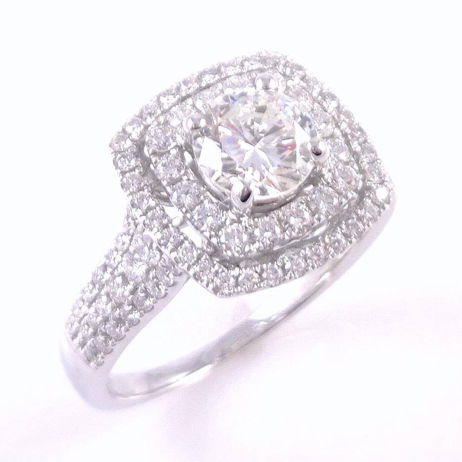 1.90 carat round brilliant cut diamond set into custom made 18k white gold diamond halo engagement ring setting. Total diamond carat weight: 3.65 ct
